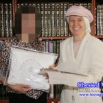 Shoshanah Shear and Orphan Kallah Receiving Gifts from Chessed Ve'Emet